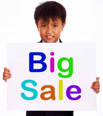 A child holding big sale giveaway placard