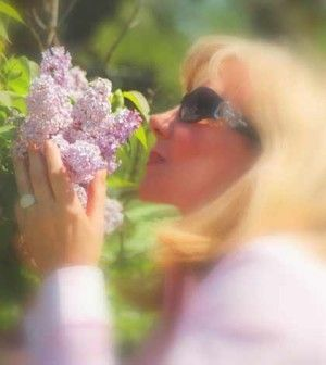a woman loving flowers and feeling good to achieve wellness in life