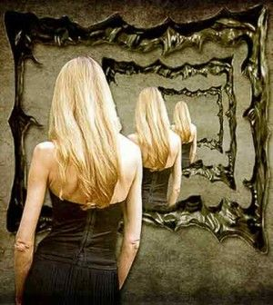 a woman standing in front of mirror tying to find the perfect woman within