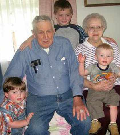 Grandparents sitting with their grandchildren