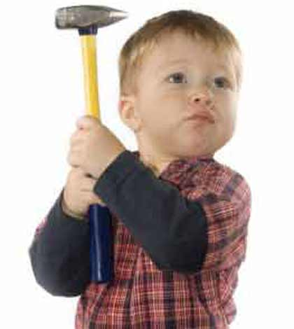 kid showing bad temper with a hammer in hand