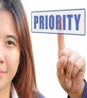 Girl shown as setting priorities of her life by pressing a button