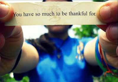 person holding a paper note telling to be grateful and thankful in life