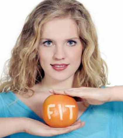 a girl holding an orange showing a healthy lifestyle option