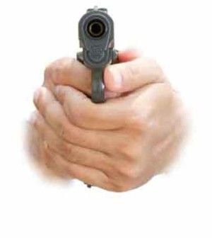 a person pulling gun trigger as threat to stop violence