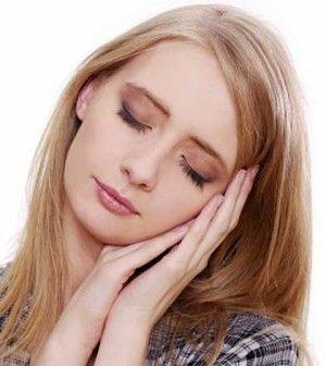 a girl wondering why do we sleep