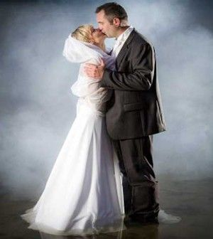 bride and groom kissing expressing romantic kind of love