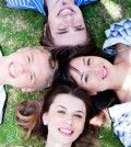 four loving and true friends with heads joined to express soulmates