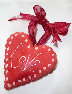 a red pendant with love written to express love to loved ones