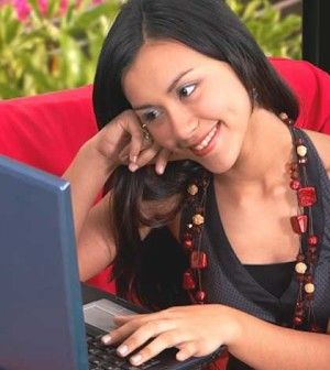 A girl chatting online social networking friendship on laptop