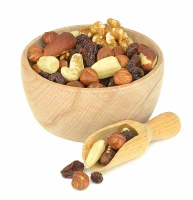 a bowl containing all good fat nuts