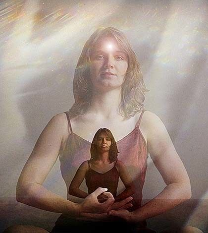 a girl sitting in meditative posr and using the power of belief