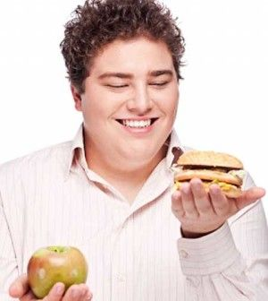 Man with good and bad fat food