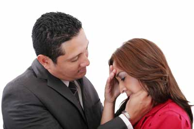 Man comforting woman in a love relationship