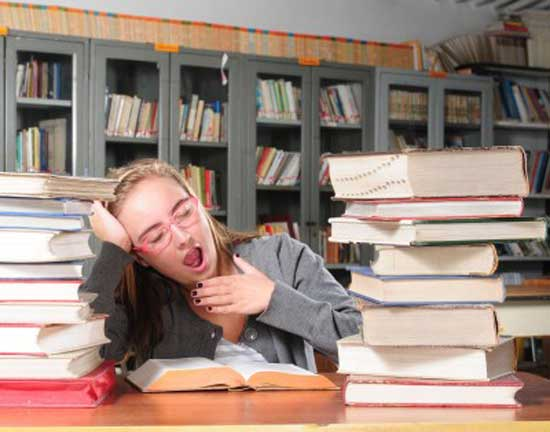 girl yawning due to lack of sleep