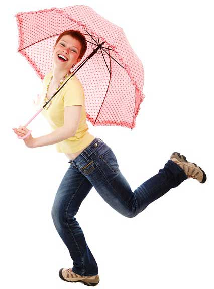 woman dancing with umbrella feeling good