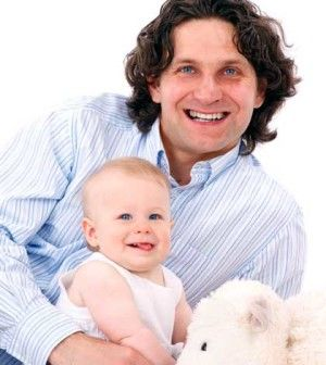 Man playing the role of father in child development with his baby