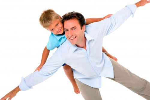 child experiencing importance of a father by enjoying ride on his back