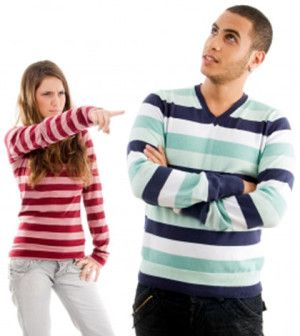 a girl pointing finger to boyfriend having friendship problems