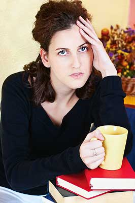 A girl drinking coffee which is one of the ways to reduce stress