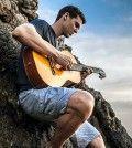 Man having holiday fun playing guitar