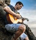 Man having holiday fun playing guitar