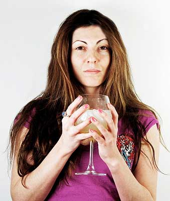 a woman drinking alcohol which is one of the ways to reduce stress