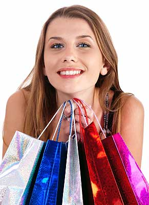 Woman holding bags after shopping spree as ways to reduce stress