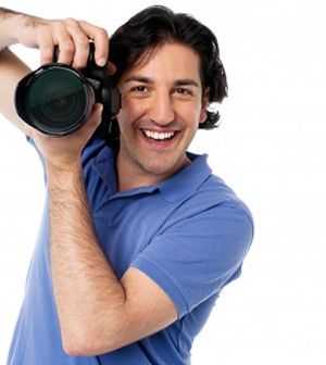 Man happy after choosing a career as photographer