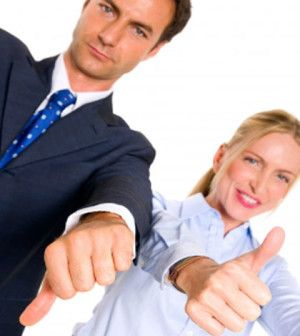 man and woman with thumbs up and down telling key to success