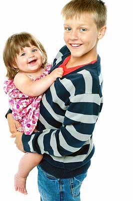 young teen boy babysitting a baby girl