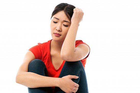 Girl sitting with teenage depression