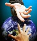 One hand helping others by extending over a globe