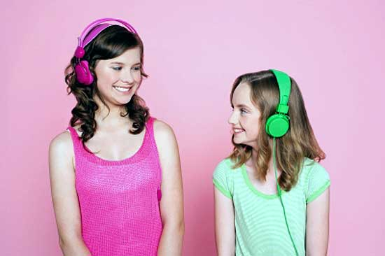 Two teens with headphones listening music for stress relief