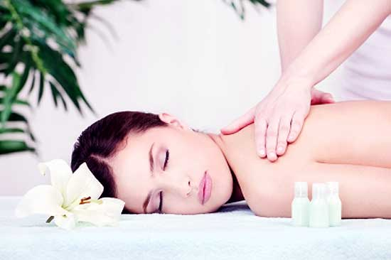 woman getting massaged for relieving stress