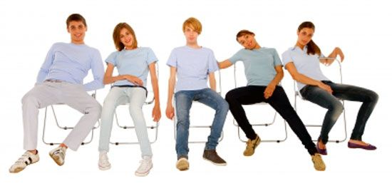 Young kids sitting in poor posture