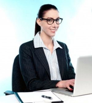 Correct sitting posture of a woman working in office