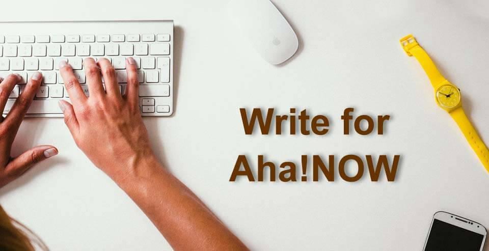 A person typing on keyboard writing a guest blog post for Aha!NOW