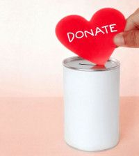 A person experiencing the joy of giving by donating