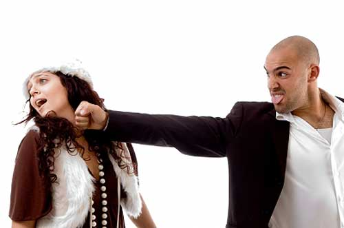 man showing domestic abuse hitting his wife