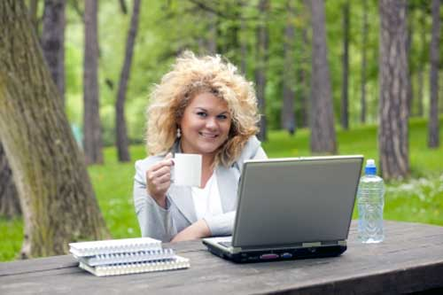 woman enjoying quality of life with office in nature