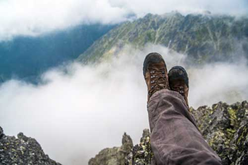 Taking a break by sitting with feet up in the lovely mountains