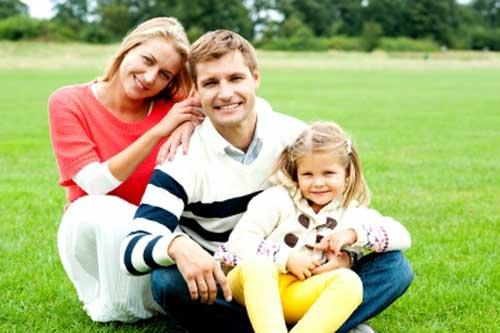 Happy family of three takes a break