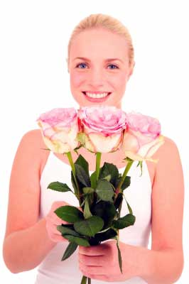 girl wishing with three flowers