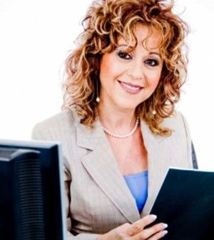 woman reading feedback surveys in office