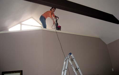photo of Ana Hoffman vacuuming her house