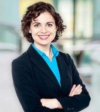 An inspiring woman blogger standing hands folded