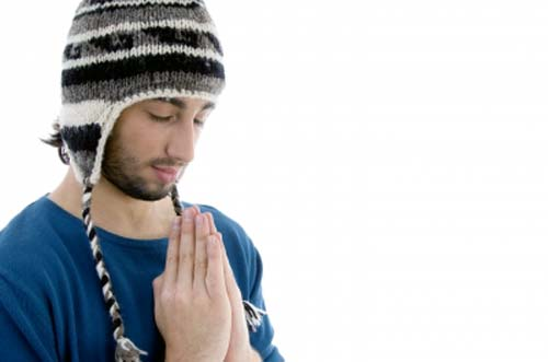 A man praying for healing with closed eyes