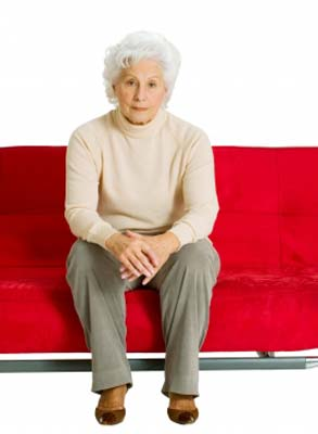 A senior lady sitting safely on sofa