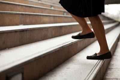 A senior climbing stair at home